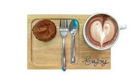 一杯咖啡 香蕉蛋糕 在一个木板的器物 图库摄影