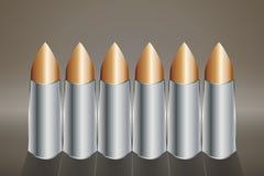 一枚铜子弹的六个回合连续站立 库存照片