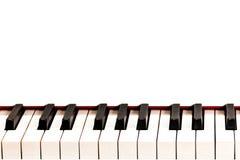 一架白色大平台钢琴的黑白钥匙 复制空间 关于音乐主题的信息 免版税库存图片