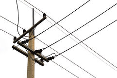 一根电杆的照片与的许多缆绳 免版税库存照片