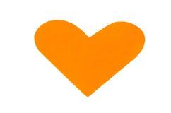 一橙色纸心脏形状为情人节 免版税库存照片