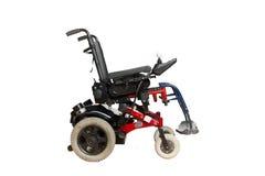 一次性人民的动力化的轮椅 免版税库存图片