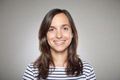一正常女孩微笑的画象 免版税图库摄影