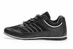 一炫耀有鞋带的运动鞋 库存照片