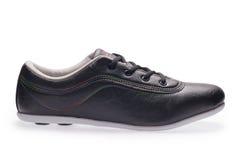 一炫耀有鞋带的运动鞋 免版税库存图片