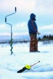 一点冬天钓鱼竿冰 免版税库存图片