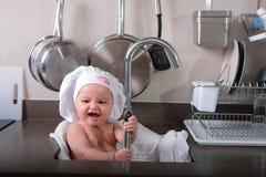 一点厨师和逗人喜爱的小男孩 库存照片