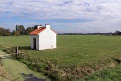 一点房子用在荷兰风景的电设备 库存图片