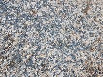 一片灰色树荫的美好的小卵石 海滩地面 设计、装饰和建筑的自然材料 铺沙的花岗岩和坚硬矿 免版税库存图片