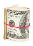 一百元钞票卷起与rubberband 图库摄影