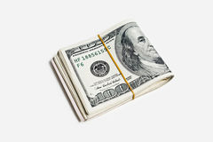 一百元钞票拿着与橡皮筋儿 免版税库存图片