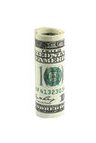 一百元钞票滚动了入卷 库存照片