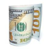 一百美元和一美元特写镜头在白色背景 库存图片