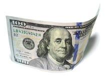 一百美元和一美元特写镜头在白色背景 免版税图库摄影