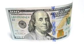 一百美元和一美元特写镜头在白色背景 免版税库存图片