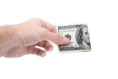 一百美元在白色隔绝的人的手上 免版税库存图片