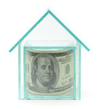 一百美元在玻璃房子里 库存图片