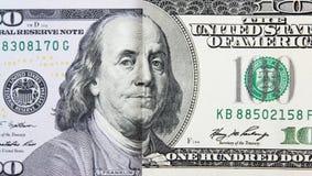一百美元钞票的一老和新的部分 库存照片