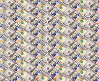 从一百美元钞票的背景 图库摄影