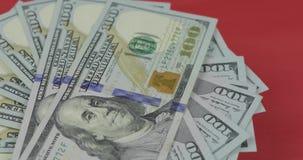 一百美国美金转动 r 与美金的背景 股票视频
