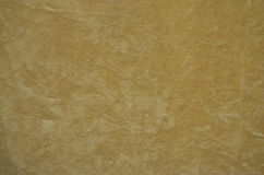 从一种米黄完善的绒面革织品的背景 免版税库存图片
