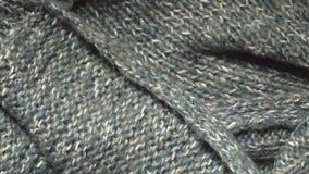 一种绿色丙烯酸酯的被编织的织品的纹理在的纺织品购物 t 股票录像