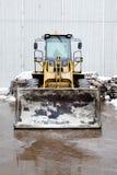 一种装载者挖掘机建筑机械设备在一个工业区 库存图片