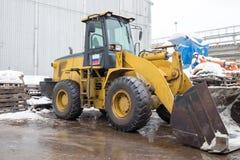 一种装载者挖掘机建筑机械设备 免版税库存照片