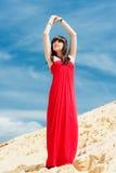 一红色礼服摆在的一个女孩 图库摄影