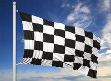 一级方程式赛车挥动的旗子在旗杆的 免版税图库摄影