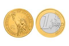 一美元和一欧元硬币 免版税库存照片