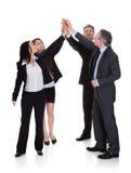 一起举手的小组买卖人 免版税库存照片