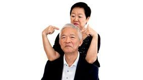 一起亚裔资深祖父母 爱,原谅和understandi 库存照片
