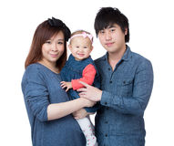 一起微笑愉快的家庭的画象 免版税图库摄影