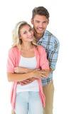 一起微笑有吸引力的夫妇年轻人 免版税库存照片
