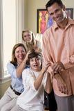 一起戏弄房子笑的妈妈的儿子 库存照片