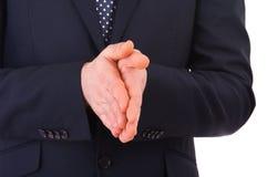 一起摩擦他的手的商人。 免版税库存图片