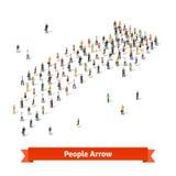 一起站立在箭头的形状的人们 免版税库存图片