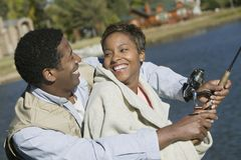 一起钓鱼的夫妇 免版税库存图片