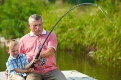 一起钓鱼 库存图片