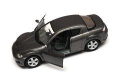 一辆两个门暗灰色玩具豪华汽车 库存照片
