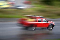 消防人员车摇摄 库存照片