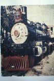 一辆古板的蒸汽机车的古色古香的样式图象在展览在旅行镇运输博物馆,洛杉矶, Califor的 库存图片