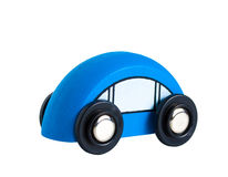 一辆小的蓝色玩具木汽车 免版税库存照片