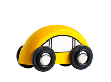 一辆小的黄色玩具木汽车 免版税库存照片