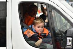 一辆救护车的男孩在一个全国事件 免版税库存图片