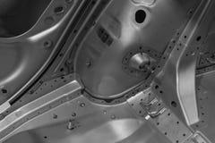 一辆汽车的金属零件在汽车生产的 图库摄影