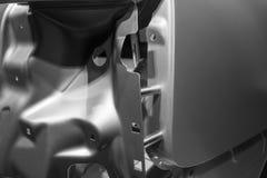 一辆汽车的金属零件在汽车生产的 库存照片