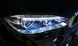 一辆现代跑车的车灯 豪华跑车正面图  汽车外部细节 汽车的车灯 免版税库存图片