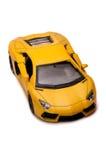 一辆老使用的黄色玩具跑车 库存照片